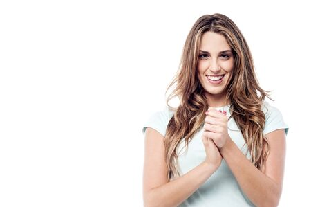clasped hands: Image of a pretty woman posing with clasped hands Stock Photo