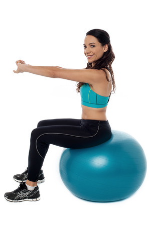 seated: Woman exercising fitness workout with swiss ball