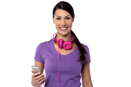 ear phones: Happy woman posing in ear phones and cell phone