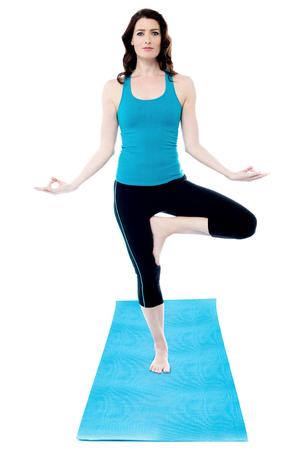 strong women: Female exercise and balance on one leg