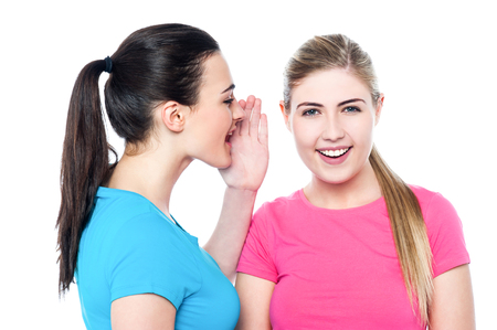 Image of friends sharing secret and having fun Stock Photo