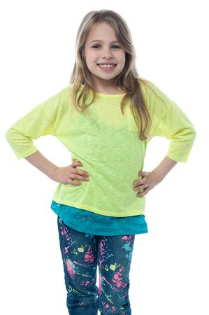 hands on waist: Pretty child posing with hands on her waist Stock Photo