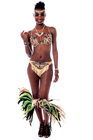 carnival costume: Young african woman in a carnival costume over white