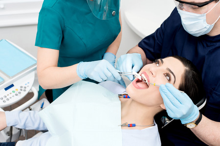 Pretty female patient receiving treatment from dentist Stock Photo - 44472235