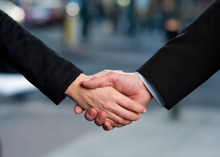 closing business: Successful business people handshaking closing a deal