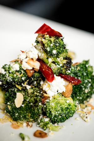broccoli salad: close up shot of broccoli salad with feta cheese