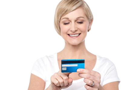 debit card: Woman looking at her name on debit card