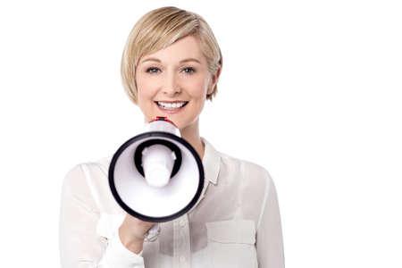 making an announcement: Woman making announcement via loudspeaker