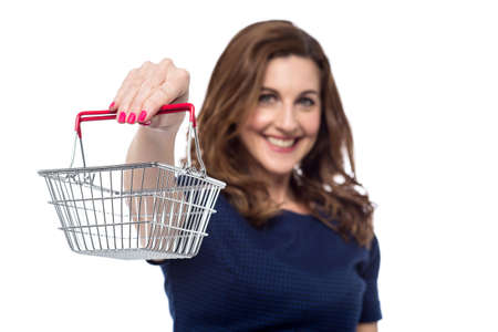 woman shopping cart: Woman offering you a shopping cart Stock Photo