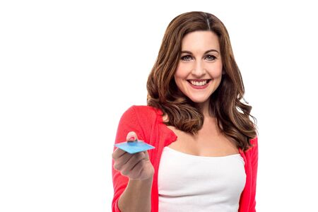 technology transaction: Cheerful woman offering her card for transaction Stock Photo