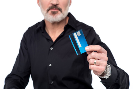 cropped image: Cropped image of a man holding atm card