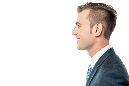 side pose: Young smiling businessman, side pose Stock Photo