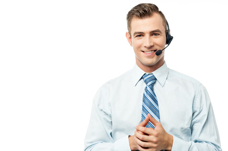 experienced operator: Young executive posing with hands clasped