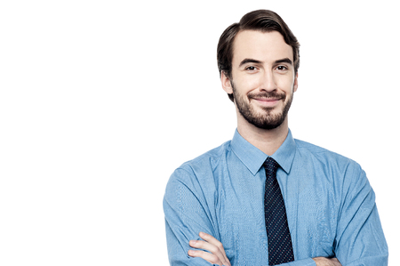 executive: Young executive posing with arms crossed Stock Photo