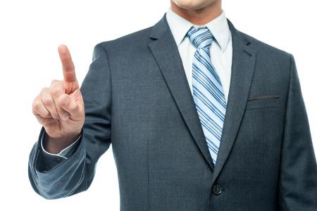 Zakenman wijst met zijn wijsvinger Stockfoto