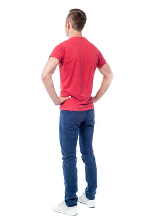facing away: Back view of a young guy in casuals