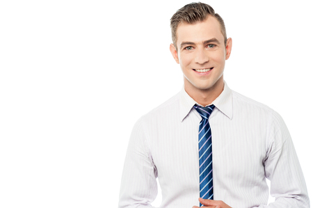 Young executive posing over white background
