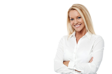 smiles: Professional woman posing over white with arms crossed