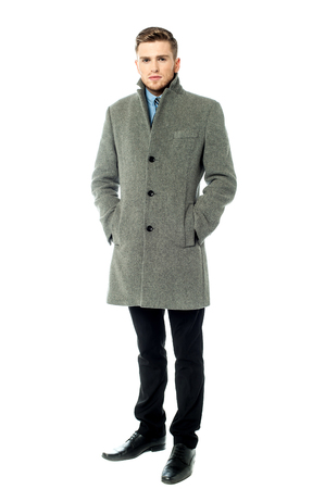 overcoat: Fashion portrait of handsome young man in overcoat Stock Photo