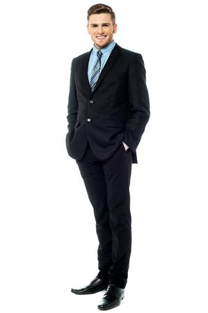 length: Businessman posing stylishly on white background