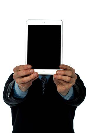 displaying: Guy displaying new tablet to camera