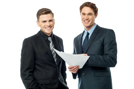 analysing: Two businessmen analysing the reports Stock Photo