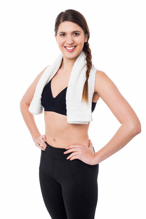 hands on waist: Pretty athletic woman with hands on waist