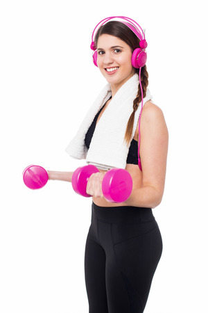 tuned: Young trainer working out, tuned into music.