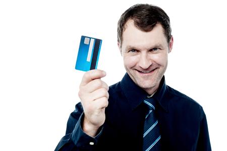 displaying: Smiling business executive displaying cash card