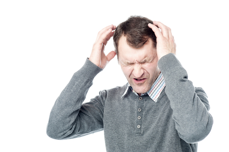 seniors suffering painful illness: Middle Age Man with Headache Holding Head in Pain