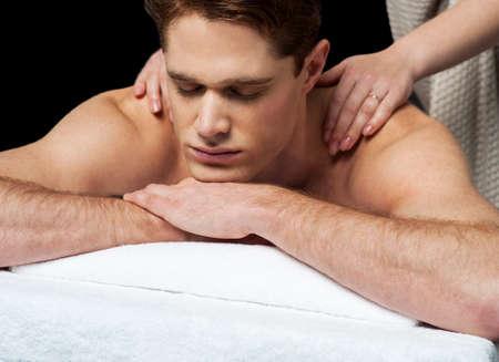 lastone: Man enjoying a wellness back massage in a spa
