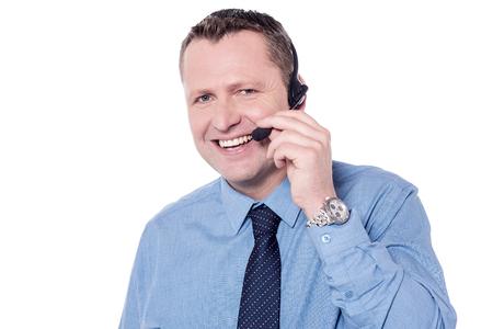 adjusting: Customer support executive adjusting headphone over white