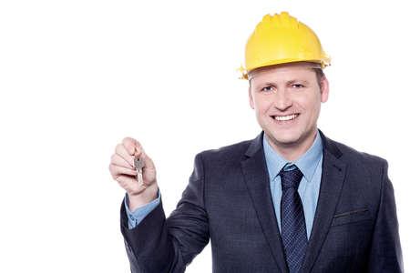 executive apartment: Male architect holding house key over white