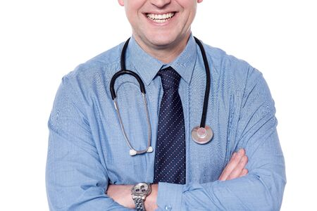 folded arms: Cropped image of a smiling male doctor with folded arms