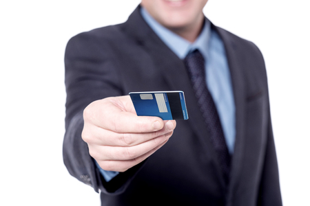 cropped: Cropped image of a businessman giving credit card