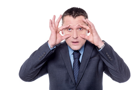 eyes open: Businessman holding his eyes open with hands