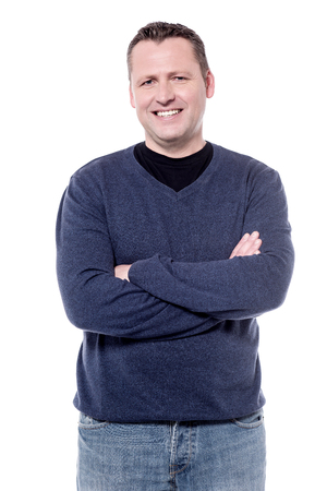 folded arms: Casual middle aged man posing with folded arms