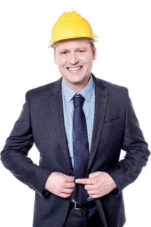 executive helmet: Smiling male engineer posing with yellow hardhat