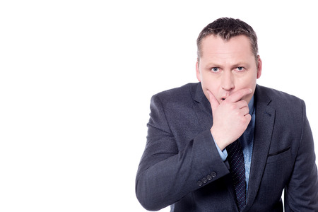 Surprised businessman covering his mouth with hand