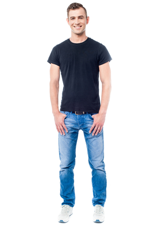attractive male: Full length image of a young guy with hands in pockets