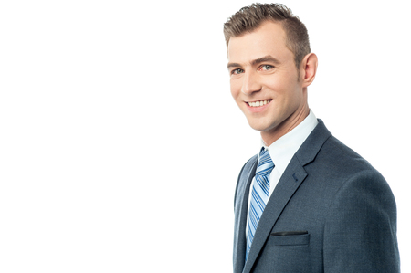 side pose: Side pose of young businessman over white