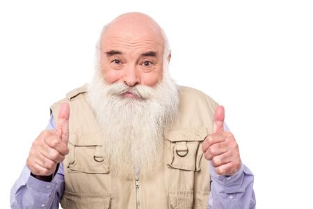 posing  agree: Image of a senior male with double thumbs up