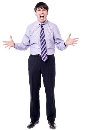 uninterested: Businessman shouting with anger on white background