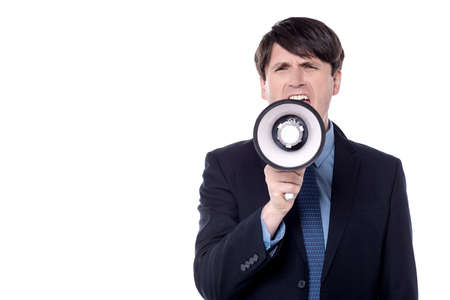 loud hailer: Businessman screaming on a megaphone, isolated over white