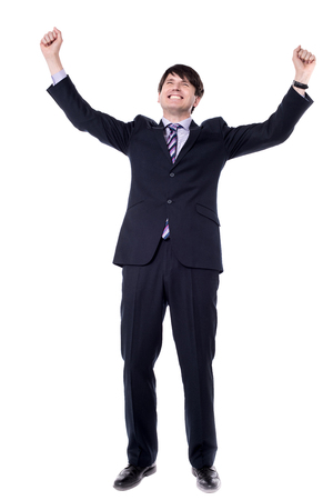clenching fists: Successful businessman clenching fists