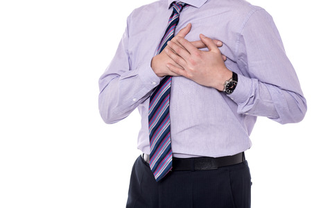 chest pain: Cropped image of a corporate executive having a chest pain