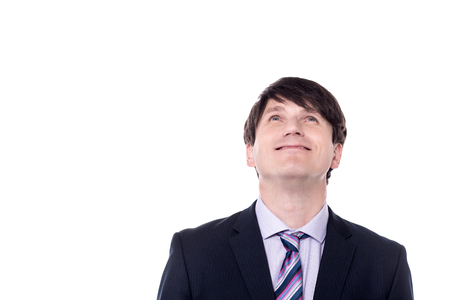 businesspersons: Portrait of a businessman looking upwards over white Stock Photo