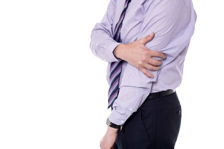 throb: Businessman suffers intense elbow pain on white background