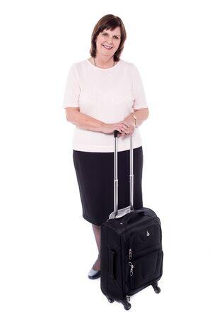 stylishly: Old woman posing stylishly with strolley bag Stock Photo