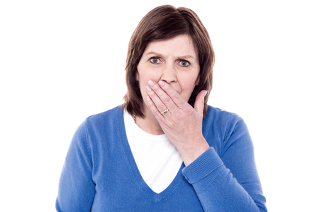 tiredness: Woman yawning of tiredness and posing to camera Stock Photo